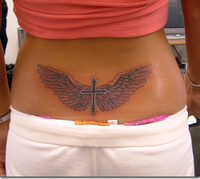 Cross wings lowerback tattoo